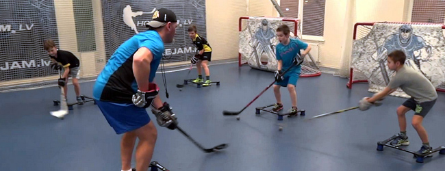 Hockey players completing training drills in the gym